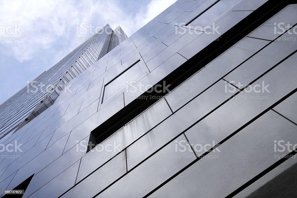 Modern Building Reflecting Cloudy Sky royalty-free stock photo