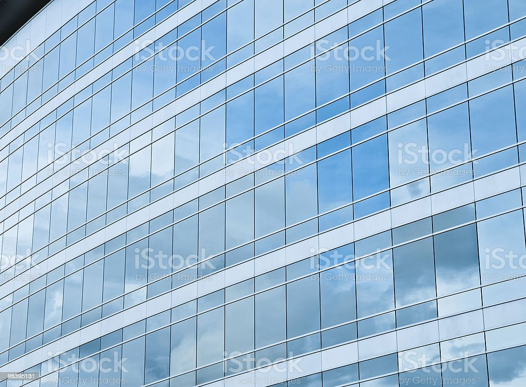 Modern building reflects sky royalty-free stock photo