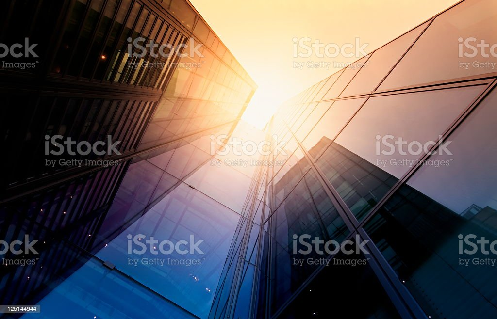 Modern building side made of glass reflecting sunlight stock photo