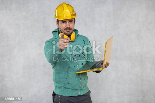 modern building supervisor keeps the computer in his hands, technology at work