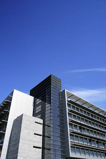 Modern building volumes on sunny day stock photo