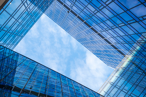 istock modern building with many glass windows in which the sky reflects 1027578084