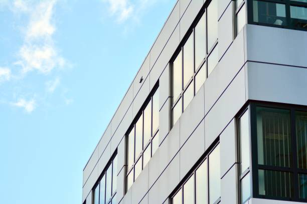 Modern building with reflected sky and cloud in glass window stock photo