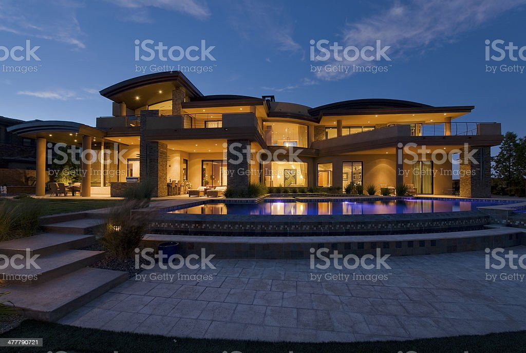 Modern Building With Swimming Pool At Dusk stock photo
