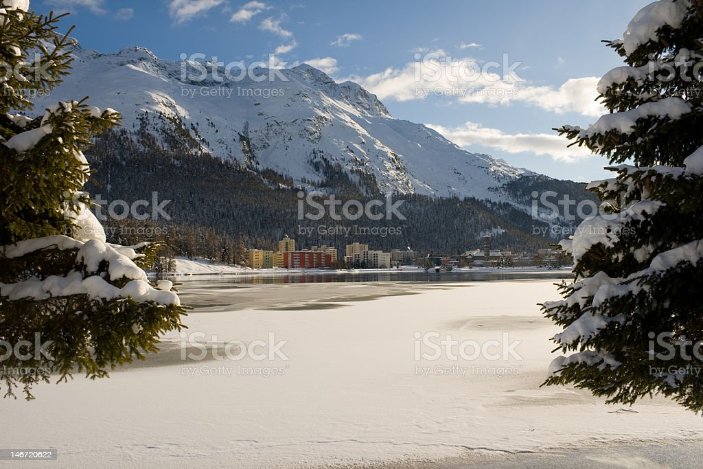 Modern buildings among a snowy landscape stock photo