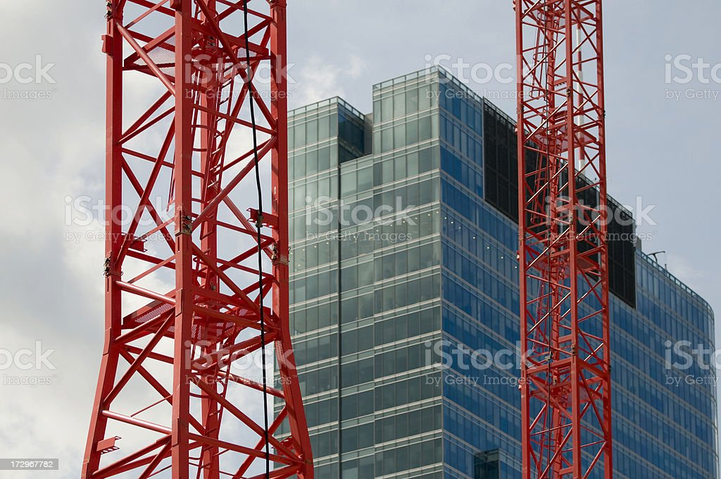 Modern buildings and cranes royalty-free stock photo