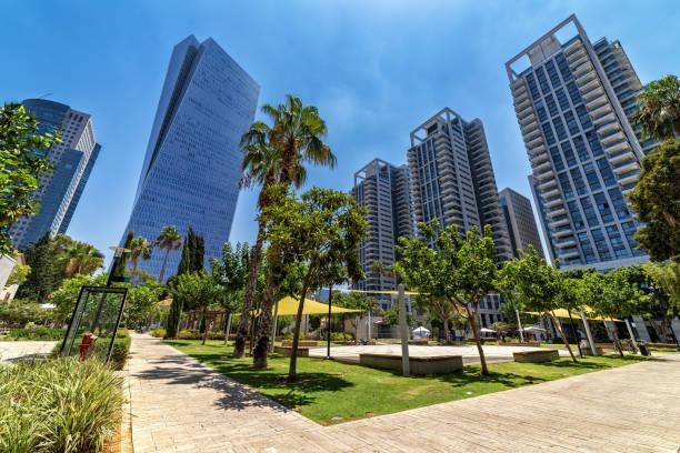 Modern buildings and urban park in Tel Aviv, Israel. stock photo