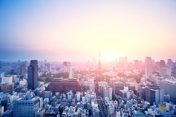 modern buildings in tokyo at sunrise stock photo
