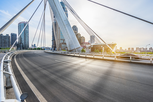 istock modern buildings with empty road 538665318
