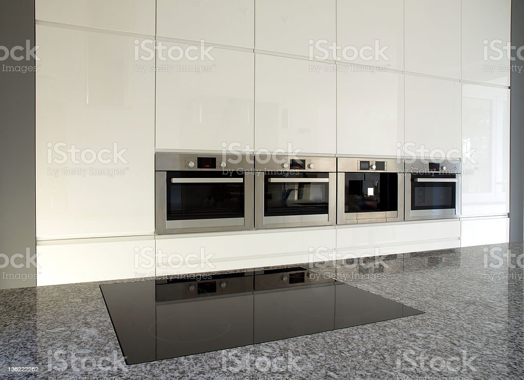Modern built-in kitchen in white royalty-free stock photo