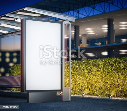 istock Modern bus stop with blank billboard at night. 3d rendering 598712058