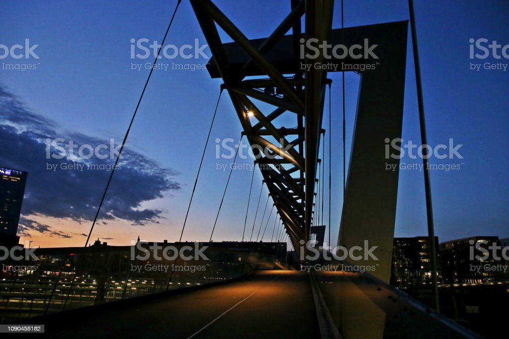 Modern business architecture in the center of Oslo at night.  Bridge across the tracks of Oslo central station. stock photo