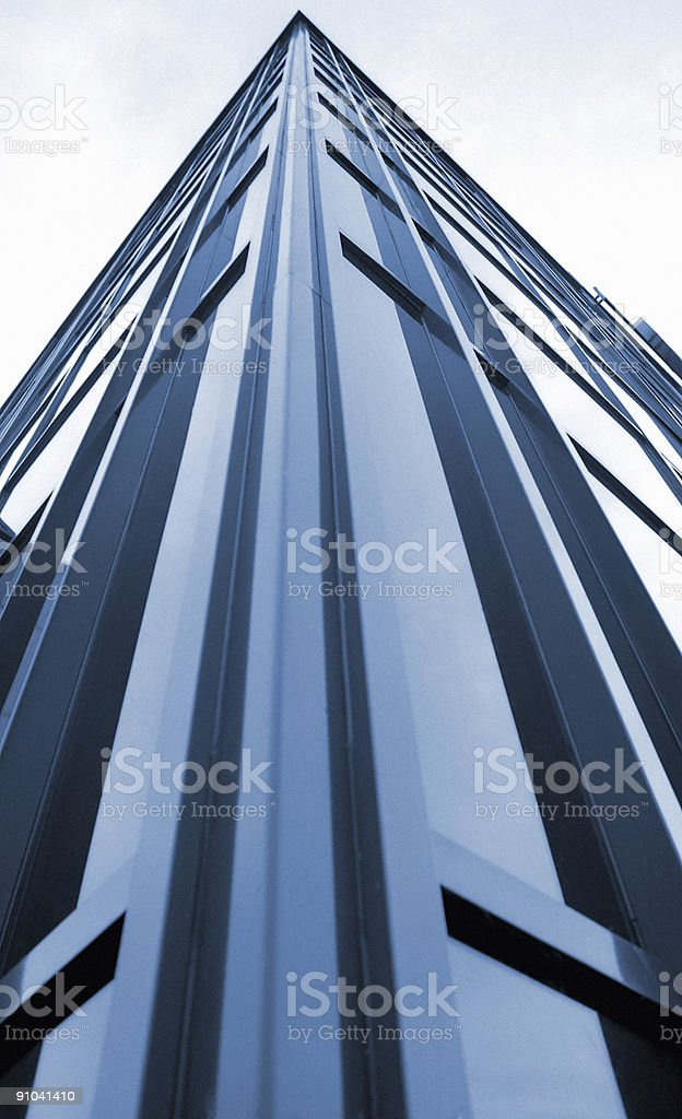 Modern business building in blue royalty-free stock photo