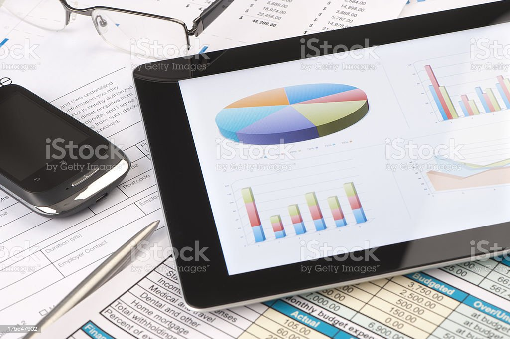 Modern business concept with digital tablet and charts royalty-free stock photo