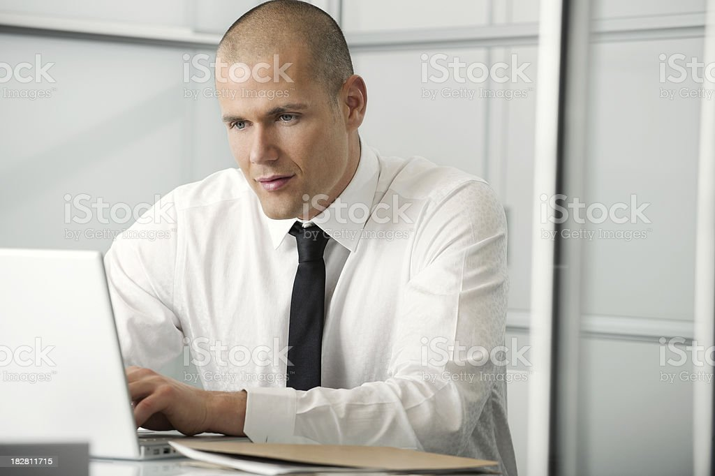 Modern business man working on his laptop royalty-free stock photo