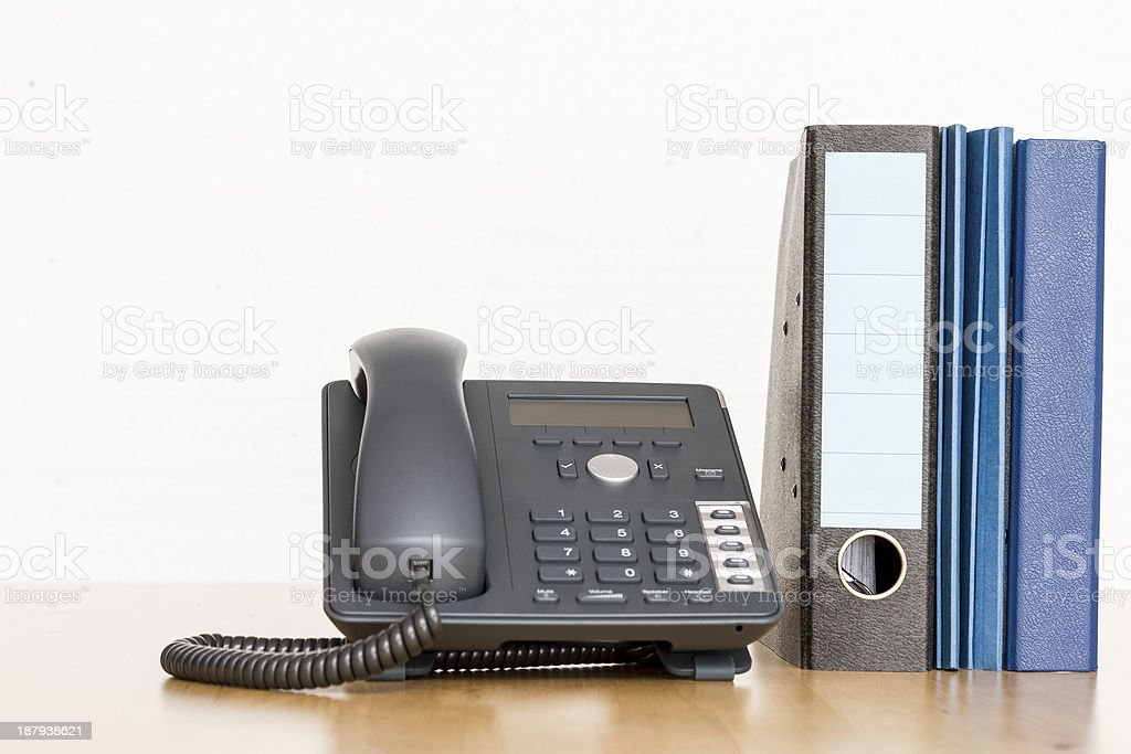 modern business phone with ring binder royalty-free stock photo