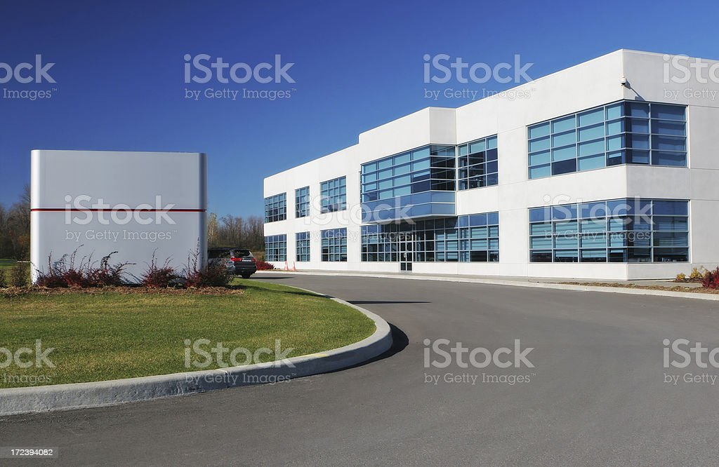 Modern Business Sign and Building stock photo