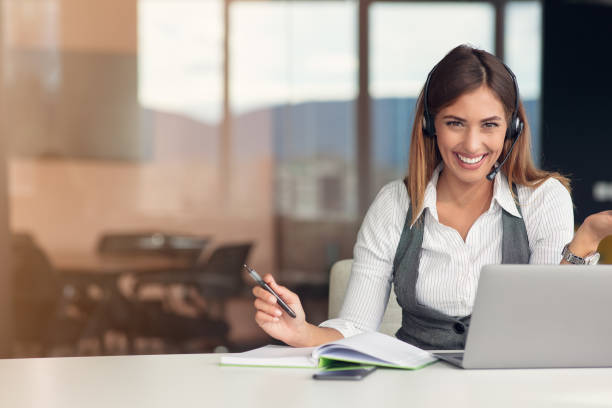 Modern business woman in the office working at computer stock photo