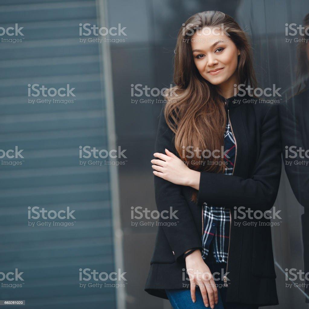 Modern business, woman near the office ponders business plan. foto de stock royalty-free