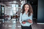 Waist up portrait modern business woman in the office with copy space
