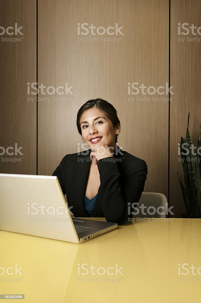 Modern business woman with her laptop and ample copy space stock photo
