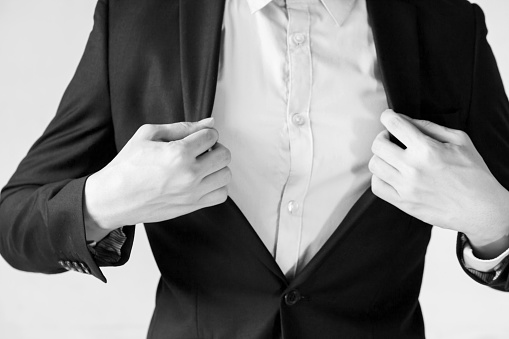 516141885 istock photo Modern businessman adjusting his suit for work preparation 580097764