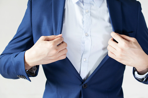 516141885 istock photo Modern businessman adjusting his suit for work preparation 585620918