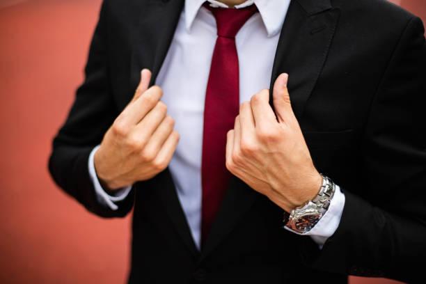 Modern businessman adjusting his suit