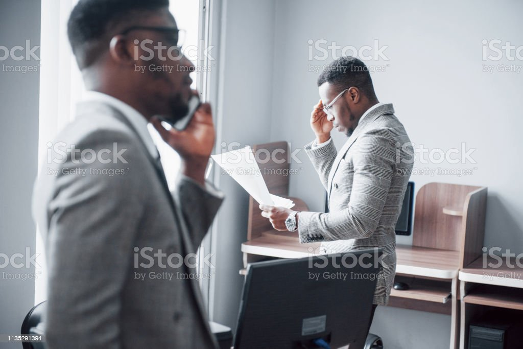 Modern businessman at work. Two confident business people in...