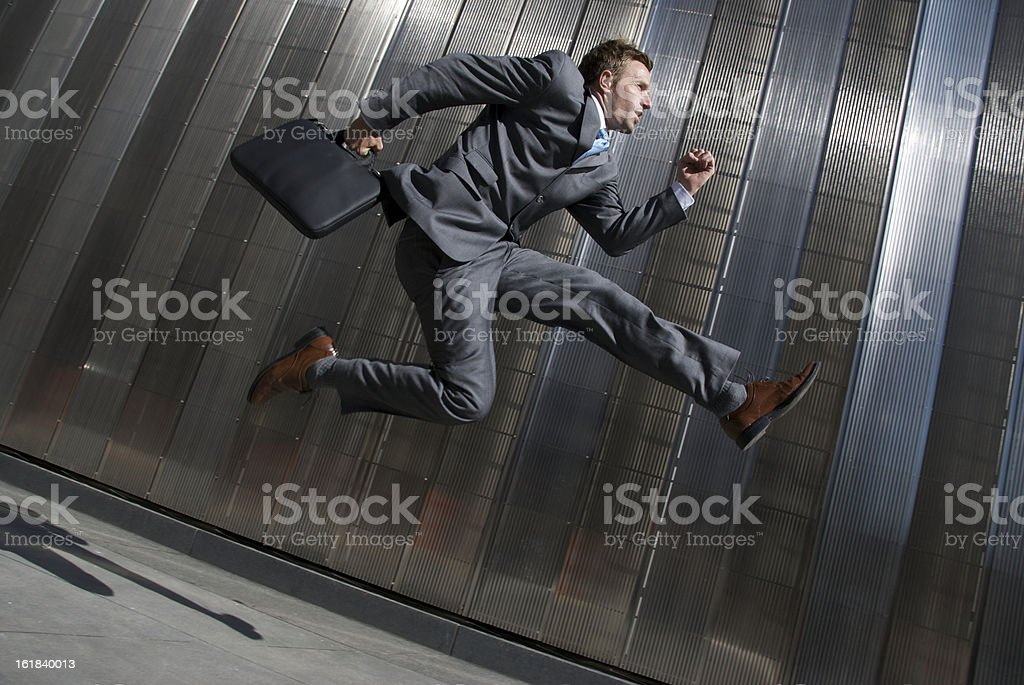 Modern Businessman Jumping Office Building City Sidewalk stock photo