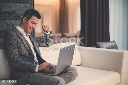 istock Modern businessman using laptop 901190064