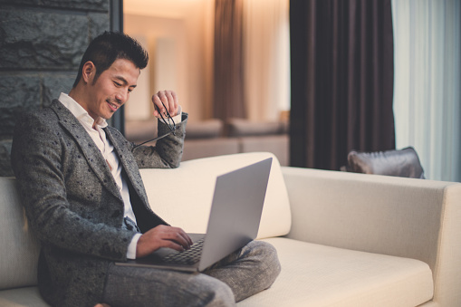 istock Modern businessman using laptop 901190064