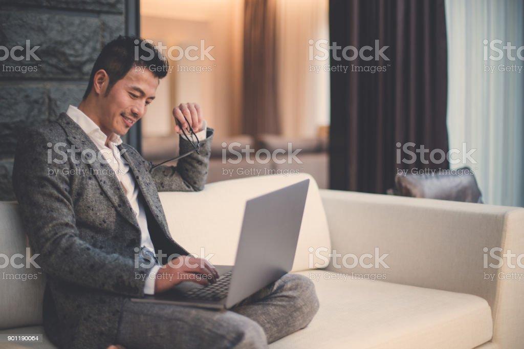 Modern businessman using laptop stock photo