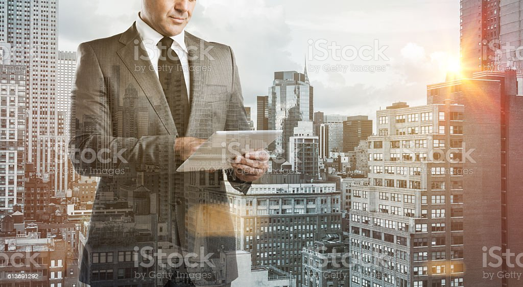 Modern businessman with tablet stock photo