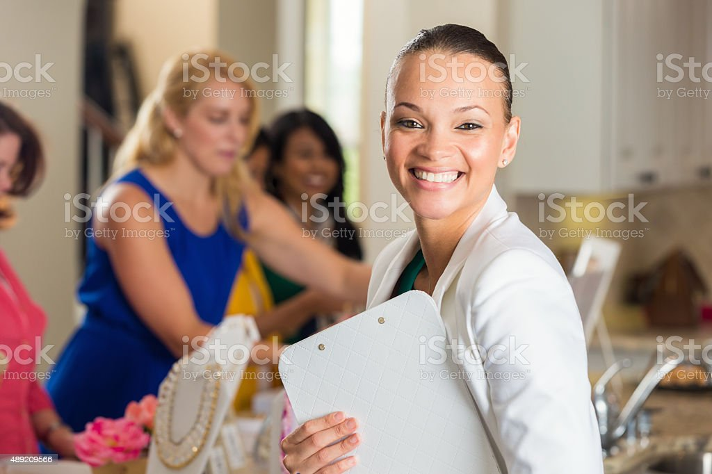 Modern businesswoman hosting direct sales party at home stock photo