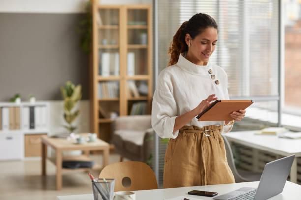 Modern Businesswoman Using Tablet stock photo