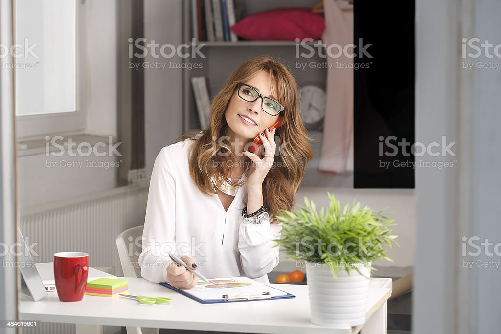 Modern businesswoman working at home stock photo