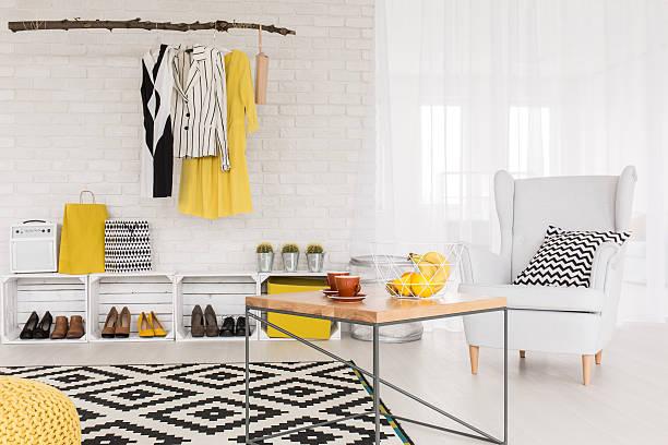 modern businesswoman's cosy living space - couchtisch metall stock-fotos und bilder