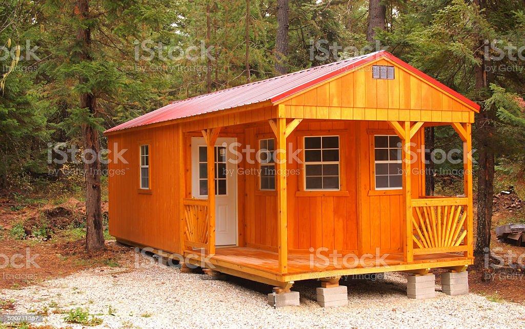 Modern cabin nestled in woods photo. stock photo