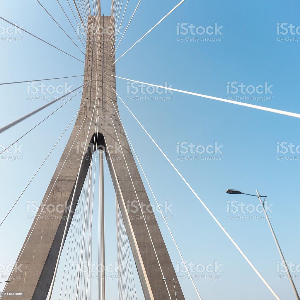 modern cable stayed bridge closeup stock photo