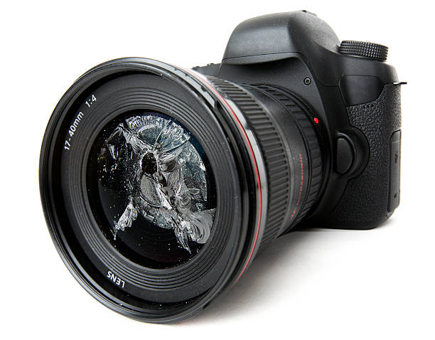 Modern camera with smashed lens stock photo