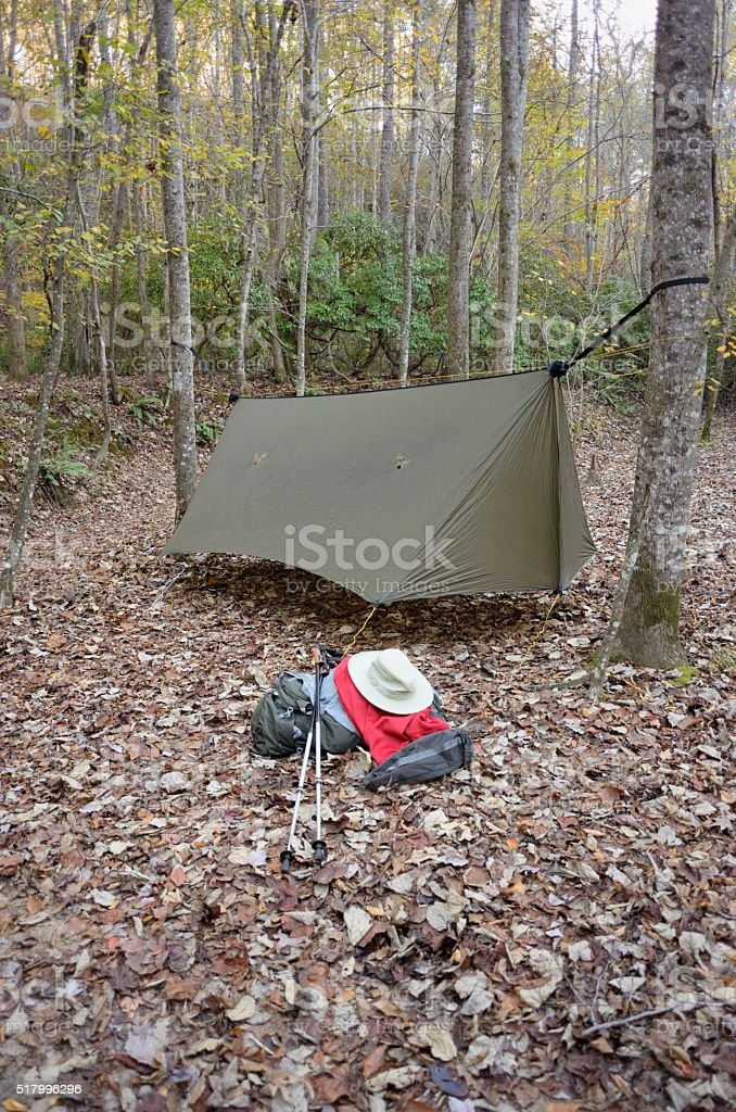 Modern camping hammock with hiking gear stock photo