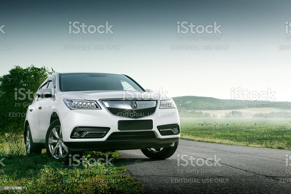 Modern car Acura MDX on road at sunset Saratov, Russia - August 11, 2015: White car Acura MDX Advance standing near asphalt road at sunset in Russia Acura Stock Photo