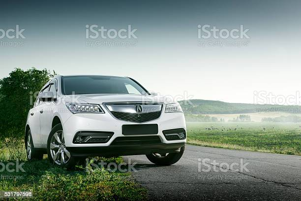 Modern Car Acura Mdx On Road At Sunset Stock Photo - Download Image Now