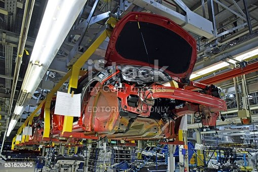 657996382 istock photo Modern car assembly plant 831826340