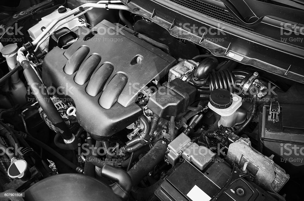Modern car engine under oped hood stock photo