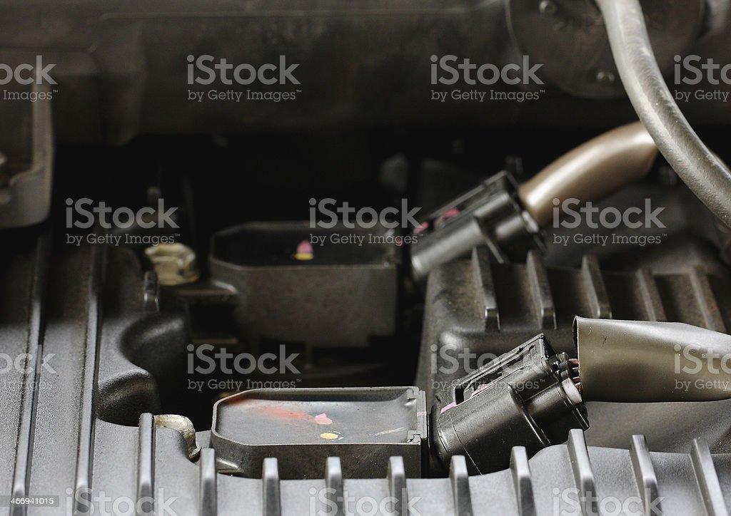 Modern car gasoline engine servicing, ratchet and spark plug royalty-free stock photo