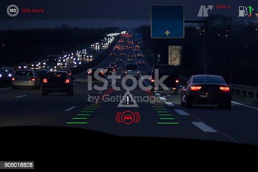 Projection of traffic and car control items on the windscreen of a modern car - headup display. Generic look.