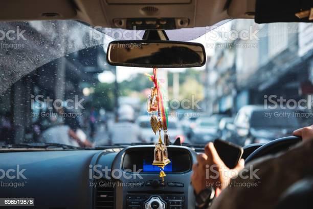 Modern car interior with hanging amulets charm on rear view mirror picture id698519878?b=1&k=6&m=698519878&s=612x612&h=o7et7cboirf81w5gdk6vqyeuaga ptehx2ink8aiejs=