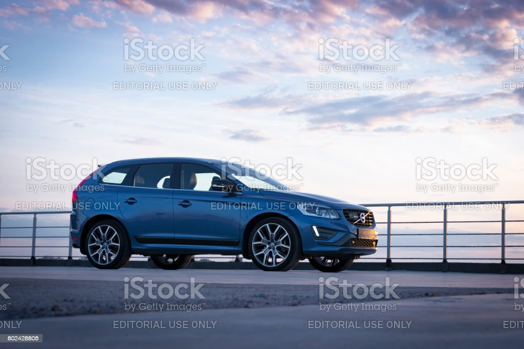 Modern car Volvo XC60 R-Design Edition on the sunset stock photo